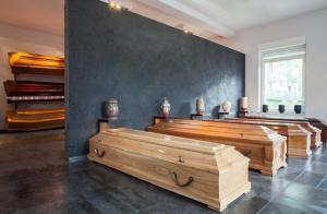 wooden caskets and urns in funeral home