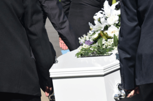 pallbearers carrying coffin